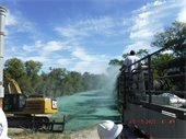 Atkins Brothers installing hydro-mulch grass seed at Rowlett Creek sewer line