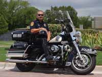 Image of a police officer on a motorcycle