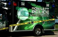 Black and green truck with Rowlett Police text on side