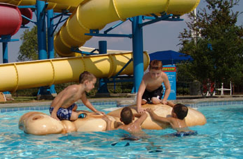 Children climbing on an in pool hippo floaty