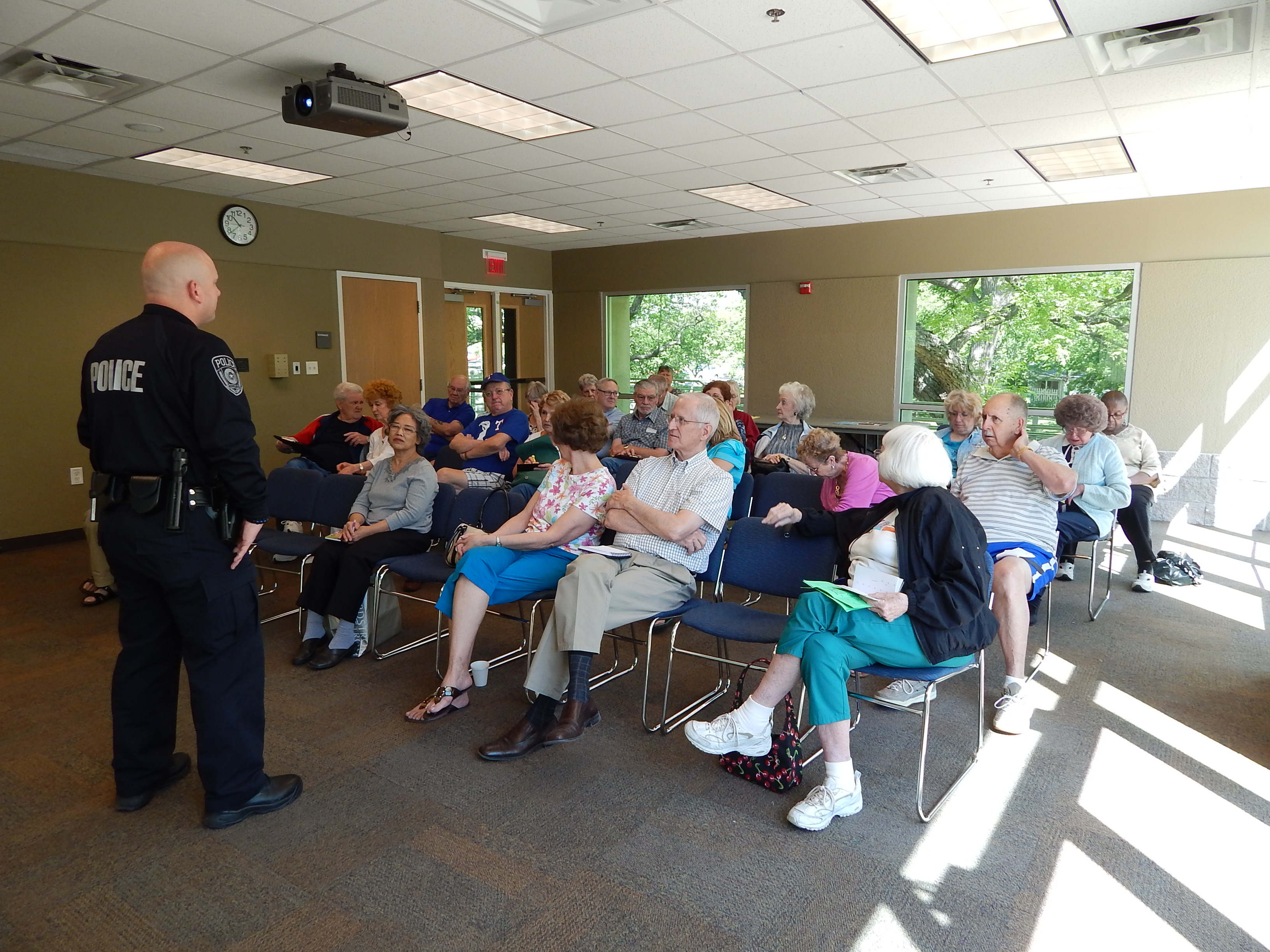 Image of a Police Officer presenting to group of older adults