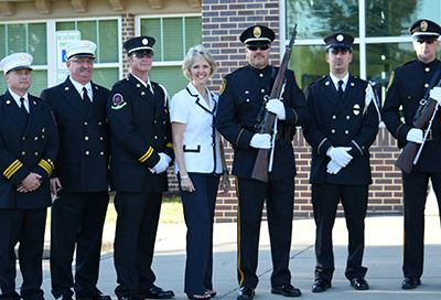 Cindy Burkett with Rowlett Police and Fire Department personnel