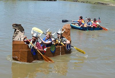 Cardboard Boat Regatta participants dressed as vikings in their boat