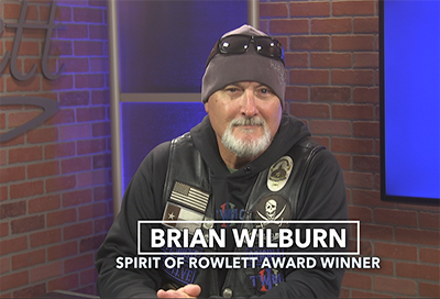 Brian Wilburn sitting at a desk - Spirit of Rowlett Awardee for December 2019