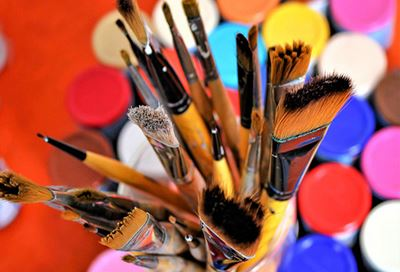 Colorful paints and paintbrushes