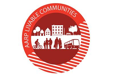 People, bus, bike, trees with the text AARP age friendly community
